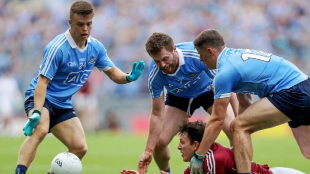 Dublin's Eoin Murchan, Jack McCaffrey and Brian Howard put the pressure on Galway's Seán Armstrong during the All-Ireland SFC semi-final at Croke Park. Photograph: Tommy Dickson/Inpho