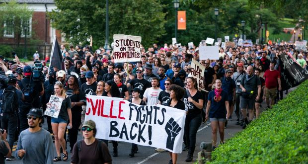 Image result for Hundreds take to Charlottesville streets a year after far-right rally