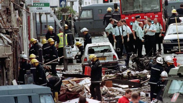 Police officers and firefighters inspect the damage caused by a bomb explosion in Market Street, Omagh on August 15th, 1998. Photograph: Paul McErlane/PA Wire
