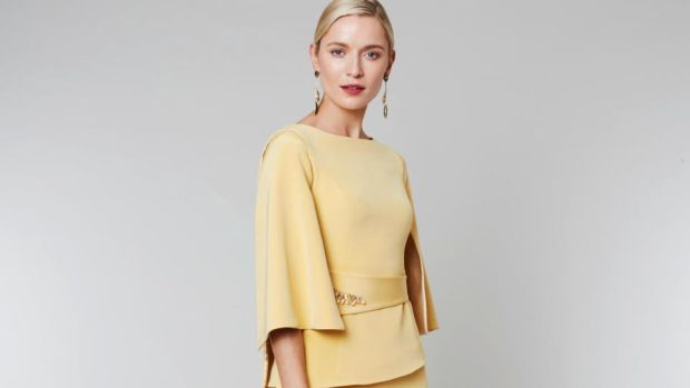 Keri – two-piece with wide cape sleeves and belt detail with crystal embellishments and an asymmetrical hemline skirt. Approx €1,600.