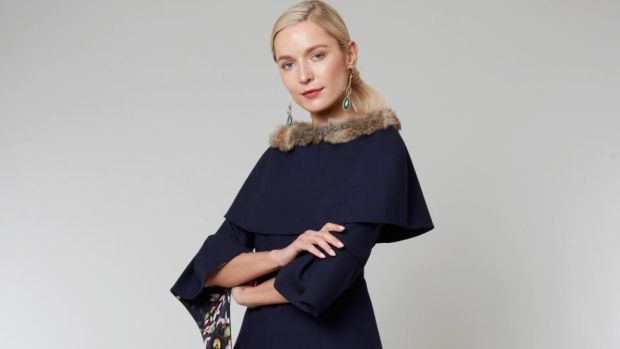 Shelly – two-piece and cape; tailored wool top with Bardot neckline, wide sleeve detail and side frill lined with silk tropical prints and crystal. It can also be made with a tailored mid-calf or full-lenth skirt in a choice of colours.