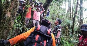 Rescuers evacuate the survivor of a crashed  aircraft in Papua, Indonesia. Photograph: Papua Cendrawasih Military Command/EPA