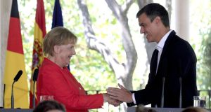 German chancellor Angela Merkel and Spanish prime minister Pedro Sanchez at a press conference in southern Spain. Photograph: A Carrasco Ragel/EPA