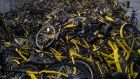 Heaps of disused, abandoned bikes in graveyards around China's cities show how hubris has soured the e-bike revolution. Photograph: AFP