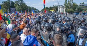 "People protesting in Bucharest: President Klaus Iohannis said ""brutal intervention"" of riot police was ""strongly disproportionate"". Photograph:  Octav Dragan/via Reuters"
