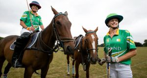 Irish international polo player Siobhán Herbst (astride horse) with colleague April Kent: Ms  Herbst is running what she says is Ireland's largest polo event, for charity, in Phoenix Park.