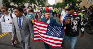 Jason Kessler (C)  marches to the White House on the anniversary of last year's 'Unite the Right' rally, in Washington, DC, US. Photograph: Jim Lo Scalzo/EPA