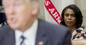Omarosa Manigault (right) sits behind US president Donald Trump as he speaks at the White House. File photograph: Saul Loeb/AFP/Getty Images