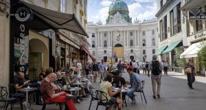 Vienna, Austria - August 7, 2014: A large group of people take a rest in the terrace of a cafe in downtown Vienna.
