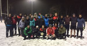 during the big snow in 2017, along with friends from Vienna Gaels GAA Club. I'm in the red in the front row, knees bared.