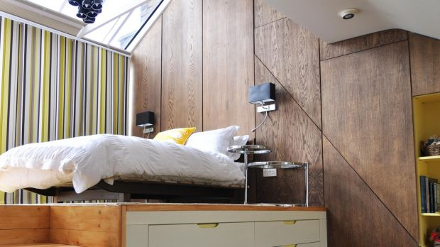 If your ceilings are high, install a platform bed so you can use the space below as storage.