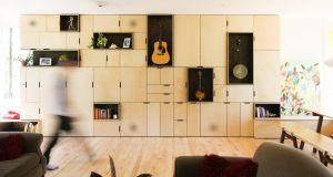 These units include open storage for the owner's collection of string instruments and closed door storage for amps.