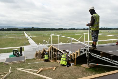 Work continues near the altar in Phoenix Park. Photograph: Dara MacDonaill/ The Irish Times