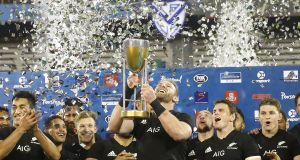 New Zealand's Kieran Read holds up the Championship trophy after victory over  Argentina at Jose Amalfitani Stadium  in Buenos Aires, Argentina. Photograph:  Gabriel Rossi/Getty Images
