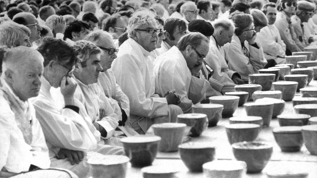 Priests wait to distribute Holy Communion. Photograph: The Irish Times