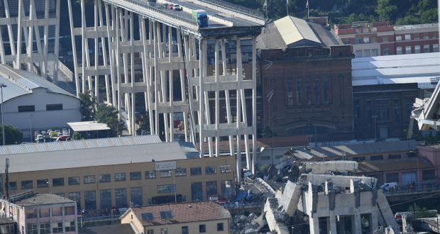 Genoa bridge collapse kills at least 35 as search for survivors a view of a collapsed section of a bridge in genoa italy photograph fandeluxe Images