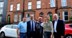 Builder Gary Martin, Francis Doherty of Peter McVerry Trust, David Carroll of Ravenswood, director of fund raising Anne Marie Conway, and trust chief executive Pat Doyle at the three buildings on Sherrard Street. Photograph: Cyril Byrne