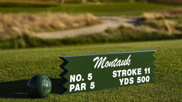 A tee marker for the Par 5 fifth hole 'Montauk' sits on display during media day for the 2018 US Open Championship at Shinnecock Hills Golf Club on October 4th, 2017, in Southampton, New York. Photograph: Keyur Khamar/PGA Tour
