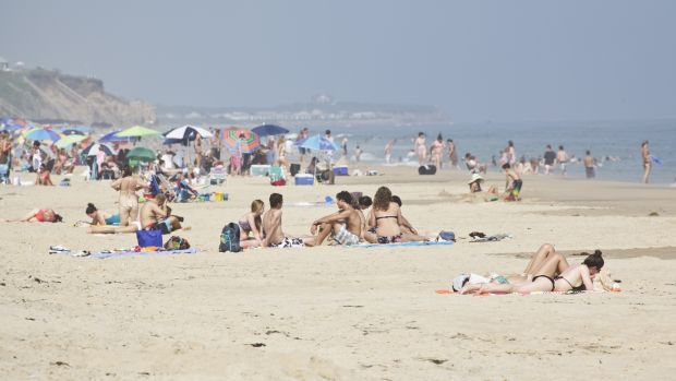 People take in the sun on the beach at Montauk. Photograph: James Leynse/Corbis via Getty Images