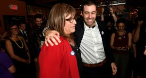 Vermont Democratic Party gubernatorial primary candidate Christine Hallquist, a transgender woman, attends her election night party with her campaign manager Cameron Russell in Burlington, Vermont, on Tuesday. Photograph: Caleb Kenna/Reuters