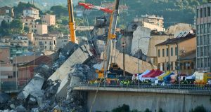 Rescuers search the crumbled hulk of the collapsed Morandi highway bridge in Genoa. Photograph: Luca Zennaro/ANSA via AP