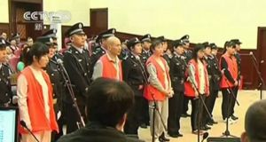 Defendants on trial for the murder of a woman at a McDonald's restaurant in eastern China in 2014. Her attackers claimed she was a demon when she refused to hand over her mobile phone.