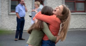 Muireann Twomey (right) from Clara from Co Kilkenny and Lynn Fenton (left) from Rathangan Co Wicklow getting their Leaving Certificate results at Kilkenny College in Kilkenny. Photograph: Dylan Vaughan