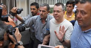 US pastor Andrew Brunson arrives at his home in Izmir, Turkey, after being released from  prison into house arrest in July of this year. The move was allowed on the  grounds of ill health, according to  Turkish authorities.   File photograph: Demiroren News Agency/DHA via Reuters