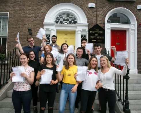 HAPPY OUT: Students at The Institute of Education on Leeson Street in Dublin celebrate their exam results. Photograph: Colm Mahady/Fennells