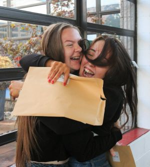 DELIRIOUS: Students Jennifer Burke and Erin Styles, both of Kilbarrack, celebrate their results at Pobalscoil Neasáin, Baldoyle, Dublin. Photograph: Gareth Chaney/Collins