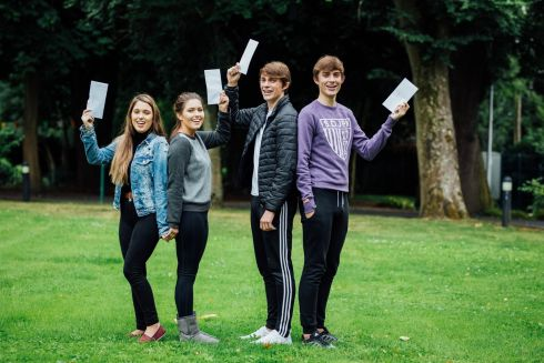 TWIN PEAKS: Twins Jessica and Rebecca O'Flynn, and twins James and Gerard Hodlinson, were all delighted with their results at Villiers School in Limerick. Photograph: Brian Arthur