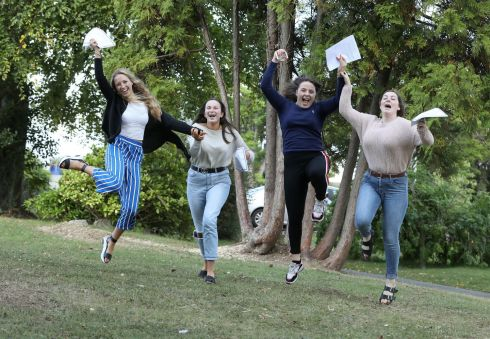 JUMP AND JIVE: Holly Vambeck of Wicklow Town (left); Anna Kavanagh, Enniscorthy, Co Wexford; Eimear O'Neill, Clonmellon, Co Meath, and AnnaBlaine, Killala, Co Mayo, celebrate their results at Rathdown School, Glenageary, Co Dublin. Photograph: Justin Mac Innes/Jason Clarke Photography