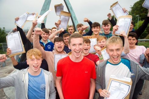 GET THE PARTY STARTED: Alex Burke (red top), from Montenotte, who scored 8 H1s, with former classmates after getting their results at Christian Brothers College, Cork city. Photograph: Daragh Mc Sweeney/Provision