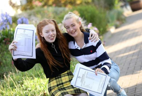 HUNKER DOWN: Lauren Rush (left) and Lilly Lloyd, from Glenageary, celebrate their results at Rathdown School, Glenageary, Co Dublin. Photograph: Justin Mac Innes/Jason Clarke Photography