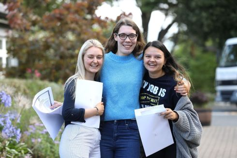 SISTERLY: Katie Grassick, Ballybrack, Dublin; Lucy Fitzsimons, Greystones, and Katie Ecock, Blackrock, Dublin, celebrate their results at Rathdown School, Glenageary, Co Dublin. Photograph: Justin Mac Innes/Jason Clarke Photography