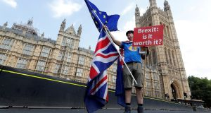 A man holds an anti-Brexit banner on Westminster Bridge in London. Photograph: Yves Herman/File Photo/Reuters