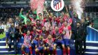 Atletico Madrid celebrate their Super Cup victory over Real in Estonia. Photograph:  Alexander Hassenstein/Getty