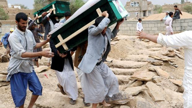 Mourners carry coffins during a funeral of people, mainly children, killed in the Saudi-led coalition air strike. Photograph: Naif Rahma/Reuters