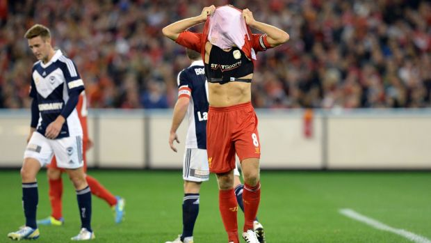 Liverpool captain Steven Gerrard (R) covers his head to show his StatSports device after missing a shot on goal against the Melbourne Victory during a football friendly match. Photograph: Mal Fairclough/AFP/Getty Images