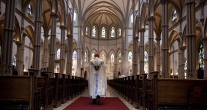 Father Kris Stubna walks to the sanctuary following a mass to celebrate the Assumption of the Blessed Virgin Mary at St Paul Cathedral, in Pittsburgh, Pennsylvania. Photograph:  Jeff Swensen/Getty Images