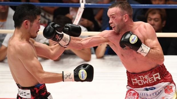 Ireland's TJ Doheny in action against Japoan's Ryosuke Iwasa during their IBF super bantamweight title boxing bout in Tokyo. Photograph: Toshifumi Kitamura/AFP/Getty Images
