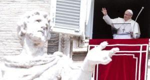 Taking the 'church-step' challenge: Pope Francis overlooking St Peter's Square. Photograph: EPA/Claudio Peri