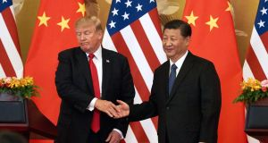 US president Donald Trump and China's president Xi Jinping in Beijing last November. Since Trump announced his trade war with China, the Chinese currency has lost 7% of its value. Photograph: Artyom Ivanov/Getty Images