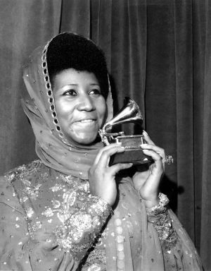 Aretha Franklin poses with her Grammy award for best female R&B vocal performance, in New York, March 3rd, 1975. Photograph: AP Photo