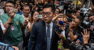 Andy Chan,  founder of the Hong Kong National Party, surrounded by members of the media as he leaves the Foreign Correspondents' Club in Hong Kong  on Tuesday. Photograph:  Philip Fong/AFP/Getty Images