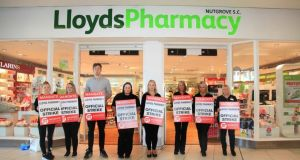 Lloyds Pharmacy workers picket the chain's Nutgrove branch in Dublin. About 270 staff in 40 of the chain's stores are due to strike for the eighth time on Saturday. Photograph: Garrett White