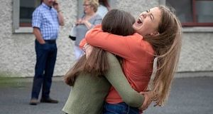 Muireann Twomey (right) from Clara, Co Kilkenny, and Lynn Fenton from Rathangan, Co Wicklow, getting their Leaving Certificate results at Kilkenny College in Kilkenny. Photograph: Dylan Vaughan