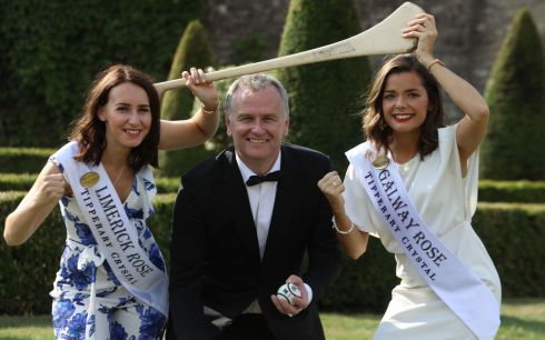 Presenter Daithi O Se poses with the 2018 Rose of Tralee contestants (Limerick) Hazel Ni Chathasaigh and (Galway) Deirdre O Sullivan at the Gardens in Kilmainham Hospital in Dublin. Photograph: Collins