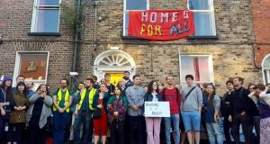 The Summerhill Occupation pictured outside  a vacant property in Summerhill Parade. Photograph: Summerhill Occupation/PA