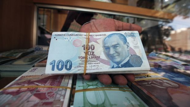 A wad of one-hundred Turkish lira notes: the currency has lost 45 per cent of its value against the dollar this year. Photograph: Yasser Al-Zayyat